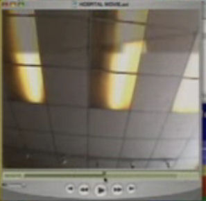 Video still - patient's eye view of a hospital ceiling