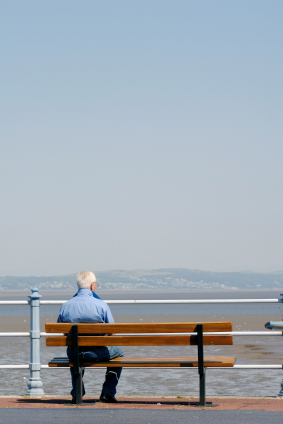 Man on a bench looking out to sea