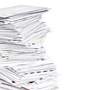 Stack of Unpaid Bills and Envelopes