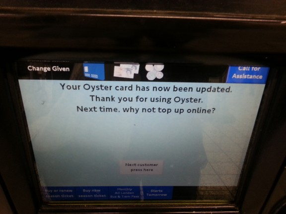 "Transport for London ticket machine showing ""Your Oyster card has now been updated. Thankyou for using oyster. Next time why not top up online?"""